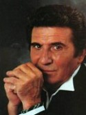 Singer Gilbert Bécaud, a French charismatic singer nicknamed Mister 100,000 volts