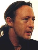 Julian Lennon, a talented musician and one of the heirs of the Beatles, looks very much like his father John.